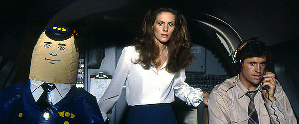"Otto the Autopilot, Julie Hagerty and Robert Hays in ""Airplane!"" (Paramount, 1980)"