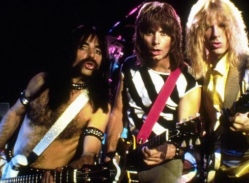 "Harry Shearer (Derek Smalls), Christopher Guest (Nigel Tufnel) and Michael McKean (David St. Hubbins) in ""This Is Spinal Tap"" (MGM/Embassy Pictures, 1984)"