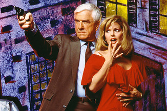 "Leslie Nielsen and Priscilla Presley in ""The Naked Gun: From the Files of Police Squad!"" (Paramount, 1988)"