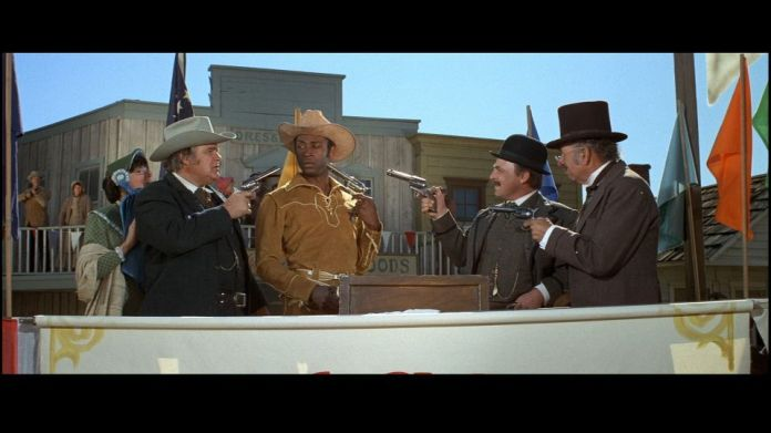 "The townspeople of Rock Ridge welcome Sheriff Bart (Clevon Little) to their town in ""Blazing Saddles"" (Warner Bros., 1974)"