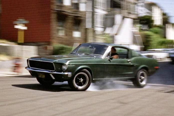 """Lieutenant Frank Bullitt (Steve McQueen) chases bad guys in a 1968 Ford Mustang GT in """"Bullitt"""" (Warner Bros., 1968)"""