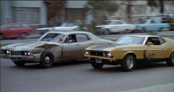"Eleanor, a 1973 Ford Mustang Mach 1, battles it out in ""Gone in 60 Seconds"" (Halicki Films, 1974)"
