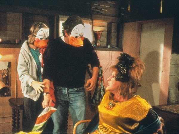 "Helen Slater and Judge Reinhold (in the duck masks) along with Bette Midler in ""Ruthless People"" (Touchstone, 1986)"