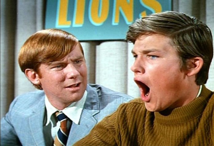 "Schuyler (Michael McGreevey) and Dexter Riley (Kurt Russell) participate in a college TV quiz show in ""The Computer Wore Tennis Shoes"" (Disney, 1969)"