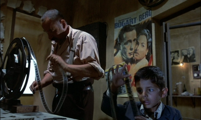 Philippe Noiret (Alfredo) and Salvatore Cascio (Toto) in 'Cinema Paradiso' (1988)